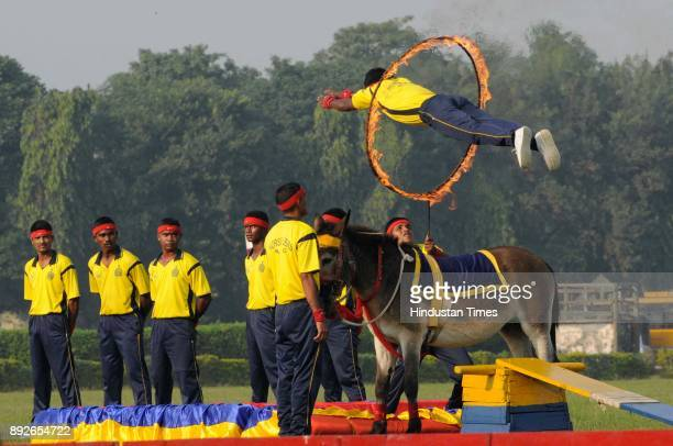 Army men display their skill by jumping through a firering during to mark the 46th anniversary of Vijay Diwas at RCTC ground on December 14 2017 in...