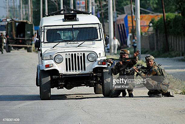 CONTENT] Army men take position near shootout scene in Hyderpora SrinagarKashmir where militants kill five Indian army men and injure several others