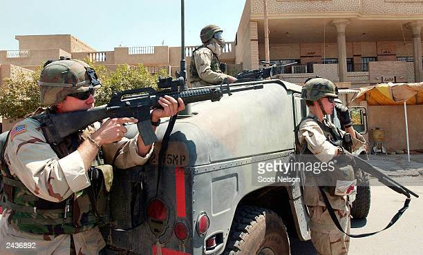 S Army military police from the 2175th MP Company based in St Clair Missouri provide perimeter security for a joint US Army Iraqi police operation to...