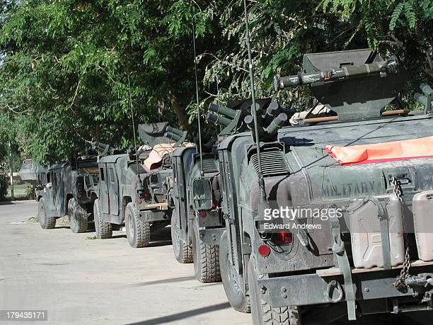 Army Military Police Humvees lined up in driveway in front of Republican Palace in Green Zone, Baghdad. I was a civilian volunteer member of a US...