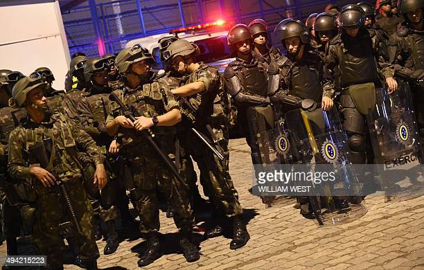 Army Military Police in riot gear prepare themselves for any protest ahead of the Australian Socceroos football team arrival at their host city of...