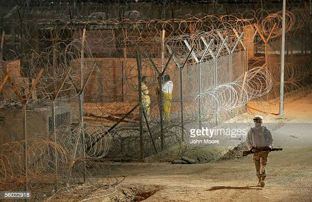 S Army military police officer patrols secure prisoner areas in the Abu Ghraib Prison October 27 2005 which is located on the outskirts of Baghdad...