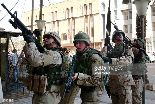 S Army military police prepare to sweep a building at the scene of an attempted bank robbery August 8 2003 in Baghdad Iraq As US forces continue to...