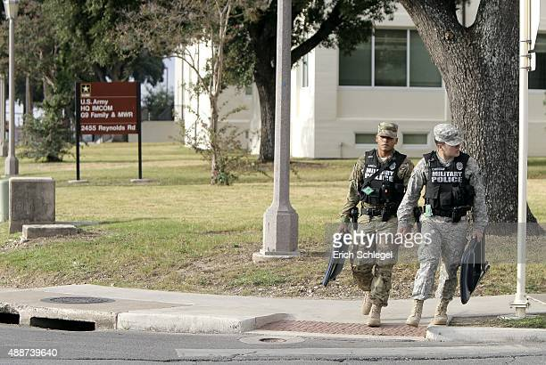 S Army military policemen walk near the area around the US Army Installation Management Command at Fort Sam Houston where the US Army holds Article...