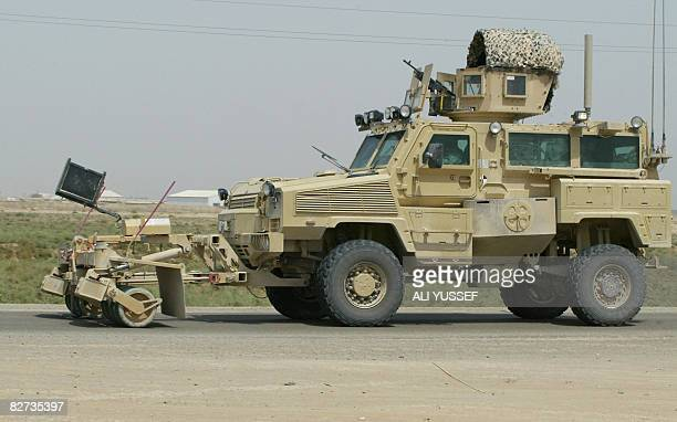 A US army Mine Resistant Ambush Protected vehicle equipped with a mine blower and a jammer rolls along a main road leading to the joint USIraqi...