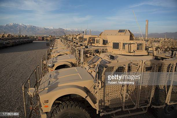 Army Mine-Resistant All-Terrain Vehicles are lined up May 9, 2013 at Bagram Air Base, Afghanistan. The vehicles will be stripped down and cleaned...
