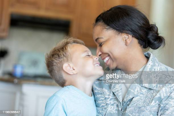 army mom and young son being affectionate - military stock pictures, royalty-free photos & images