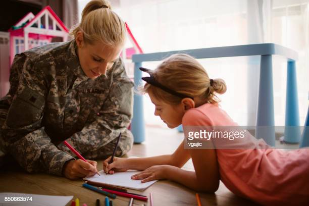 Army Mom Coloring  With Her Little Girl