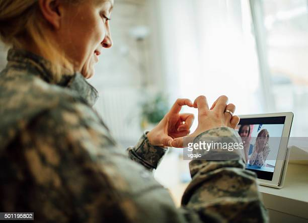 Army Mom Talking With Her Children Over Tablet.