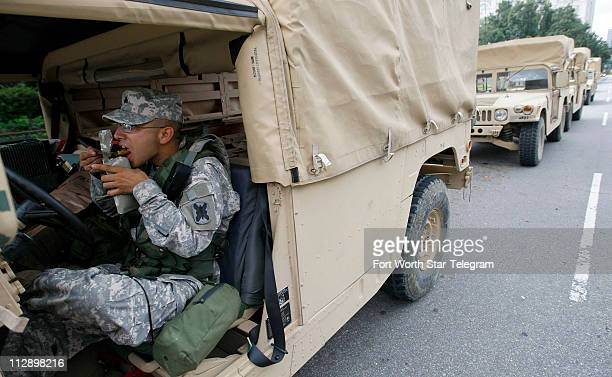 Army National Guard Sgt Sebastian Trigo grabs a quick lunch while on patrol through Jackson Square in New Orleans Louisiana as residents prepare to...