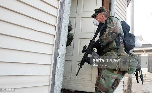 S Army National Guard soldier from Oklahoma wears a mask while conducting door to door searches September 12 2005 in New Orleans Louisiana Thousands...