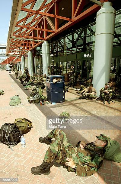 Army National Guard soldiers from Arkansas gather in front of the New Orleans Convention Center September 12 2005 in New Orleans Louisiana The area...