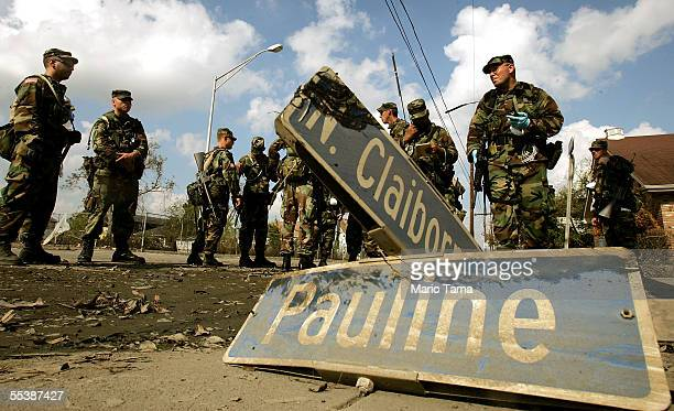 Army National Guard soldiers from Oregon gather on a street corner while conducting search operations September 12 2005 in the Ninth Ward...