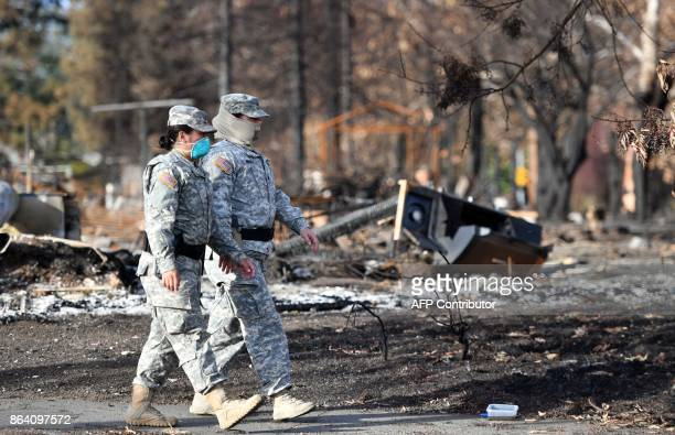 Army National Guard soldiers survey a burned neighborhood in Santa Rosa California on October 20 2017 Residents are being allowed to return to their...