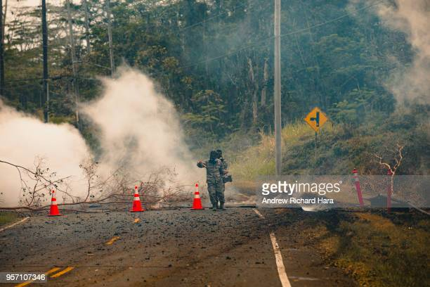 S Army National Guard soldiers take measurements for dangerous levels of sulfur dioxide gas near a volcanic fissure in the aftermath of eruptions...