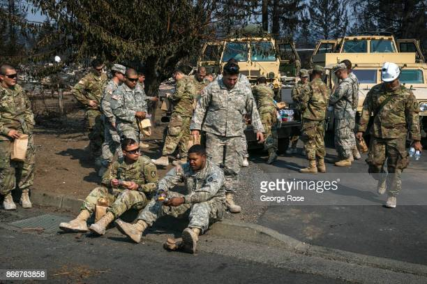 Army National Guard troops take a lunch break in the aftermath of a firestorm that began in Napa Valley's Calistoga destroying more than 2000 homes...