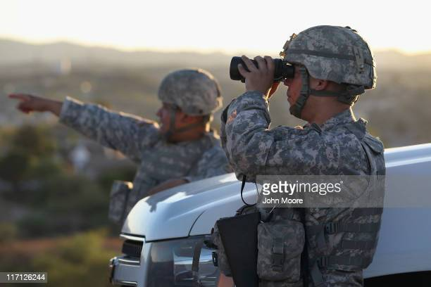 S Army National Guardsmen scan the USMexico border on June 22 2011 in Nogales Arizona The Pentagon recently extended the deployment of some 1200...