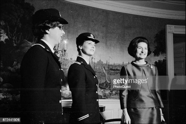 US Army nurses and Vietnam veterans Julie Klebaum and Catherine Chilling pose with First Lady Lady Bird Johnson Washington DC November 18 1965