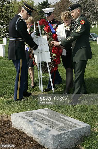 Army Officer Richard Sargent assists White House Commission on Remembrance Director Carmella LaSpada GY Sgt Christopher Cox of US Marine Corps Secret...