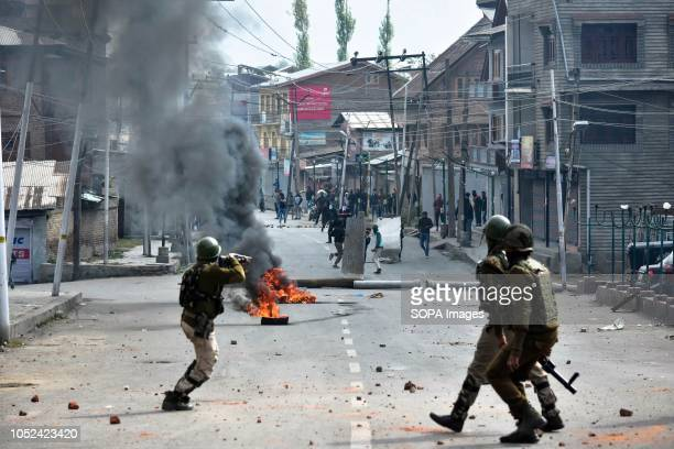 Army officer seen shooting towards the Kashmiri protesters during the clashes Clashes broke out between militants and government forces in Srinagar...
