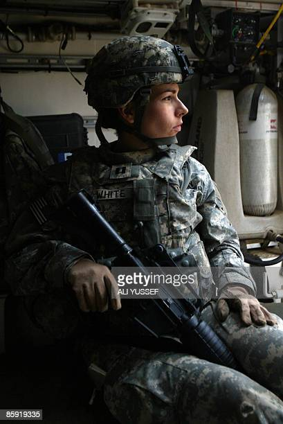 A US army officer sits in an armoured vehicle in Tarmiyah north of Baghdad on April 12 2009 Violence in Iraq remains at 2003 lows and a 2011 deadline...