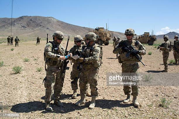S Army officers from the 4th Brigade 3rd Infantry Division discuss plans during a joint Afghan National Army operation May 6 2013 in Babus...