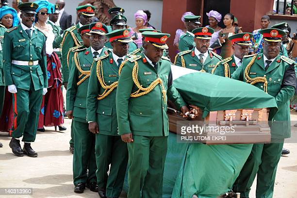 Army pall bearers carry the casket of Nigeria's secessionist leader Odumegwu Ojukwu into St Michaels Catholic Church for the funeral service in Nnewi...