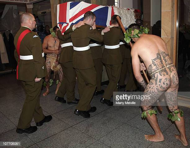 Army paratroopers carry the casket of Private Howard with a Maori Warrior escort at the Wellington Cathedral on December 21 2010 in Wellington New...