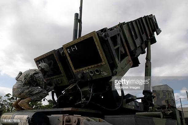 U.S. Army Patriot Missile operator simulates unlocking the launcher caps during a field training exercise on Kadena Air Base, Japan.