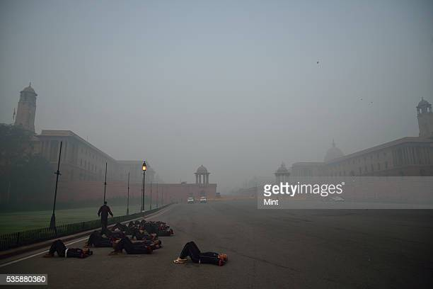 Army people excercising in early winter morning at Vijay Chowk on December 9 2015 in New Delhi India
