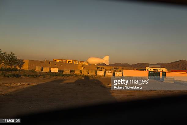 Army Persistent Threat Detection System blimp, or PTDS, remains tethered on the ground May 6, 2013 at Combat Outpost McClain, Afghanistan. The...
