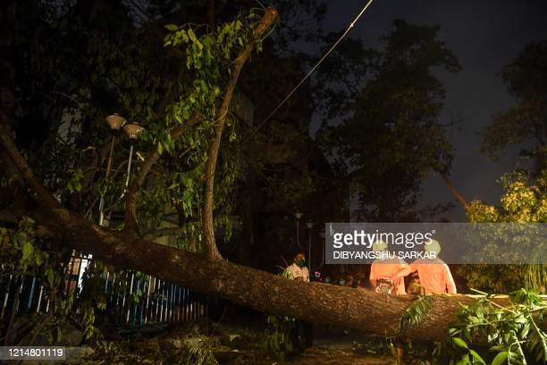 Army personnel along with National Disaster Response Force deploy to clean roads from fallen tree electric lines and others following the landfall of...