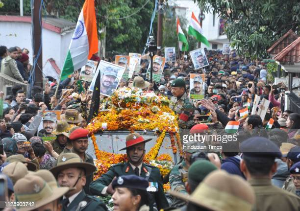 Army personnel and people pay tribute to the mortal remains of Major Vibhuti Shankar Dhoundiyal who lost his life in Pulwama encounter ahead of his...