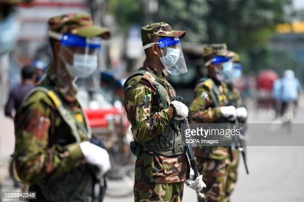 Army personnel are seen at a checkpoint during a countrywide lockdown in Dhaka. Bangladesh enacted a lockdown on July 1st in an effort to contain a...