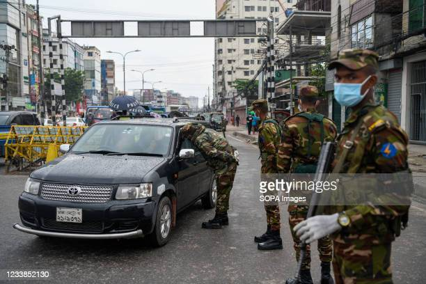 Army personnel are seen at Pragati Sarani road checkpoint during a countrywide lockdown in Dhaka. Bangladesh enacted a lockdown on July 1st in an...