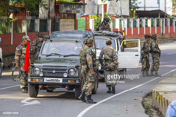 Army personnel carry out a patrol while roving during the curfew in Golaghat town in Assam following a violent clash at AssamNagaland border that has...