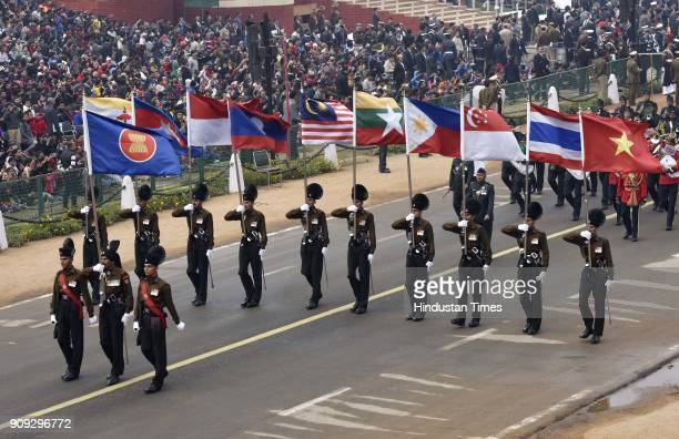 Army personnel carrying the ASEAN countries national flags pass through the saluting base at Rajpath during the full dress rehearsal for the Republic...