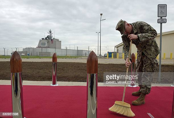 US Army personnel cleans the red carpet ahead an inauguration ceremony of the US antimissile station Aegis Ashore Romania at the military base in...