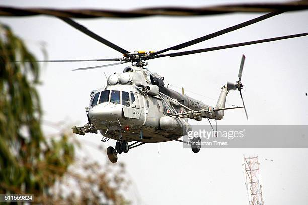 Army personnel get down from a helicopter at the Police Lines to handle the situation as Jat community protests for reservation in government...