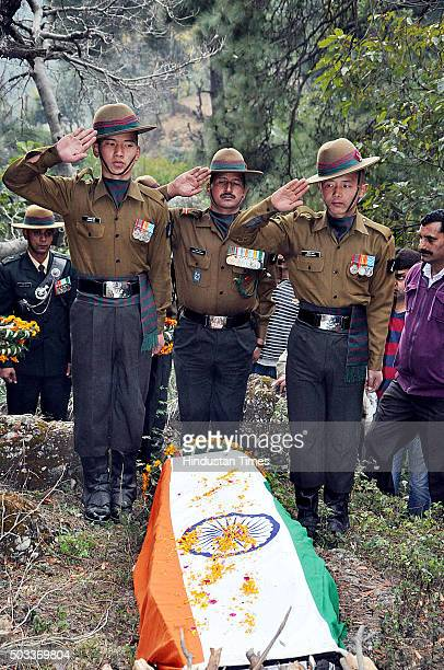 Army personnel paying tribute to martyred soldier Havildar Jagdish Chand who was killed in Pathankot terror attack during his cremation at his native...