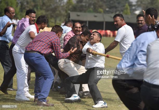 Army personnel plays tug of war during the celebration of 257th Corps Day of Army Service Corps at Agram ground on December 9 2017 in Bengaluru India...