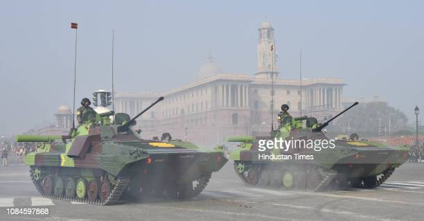 Army personnel ride on tanks during the rehearsals ahead of the Republic Day parade at Vijay Chowk on January 18 2019 in New Delhi India