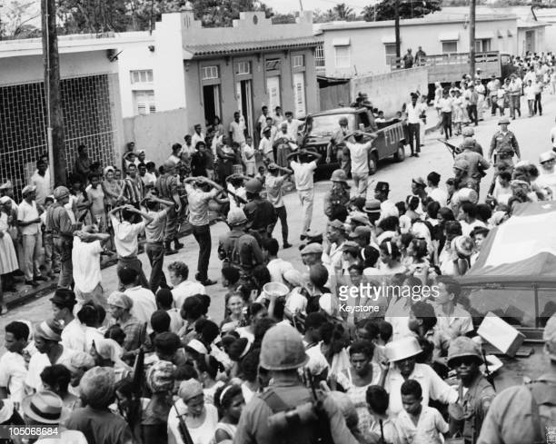 US Army personnel rounding up men suspected of unfriendly activities in Santo Domingo during the US occupation of the Dominican Republic 24th May 1965