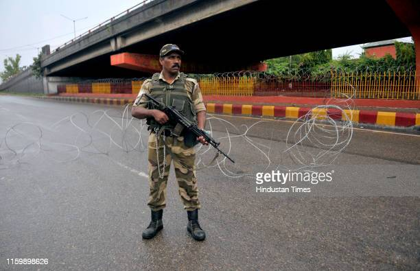 Army personnel stand guard during restrictions on August 5 2019 in Jammu India The government has imposed restrictions under Section 144 of the CrPC...
