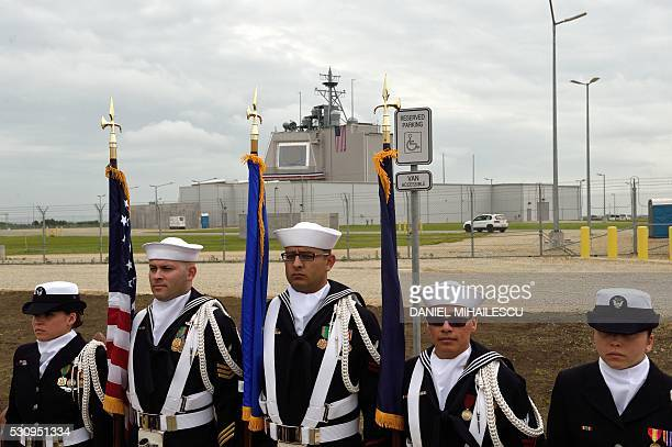 US Army personnel stand with flags during an inauguration ceremony of the US antimissile station Aegis Ashore Romania at the military base in...