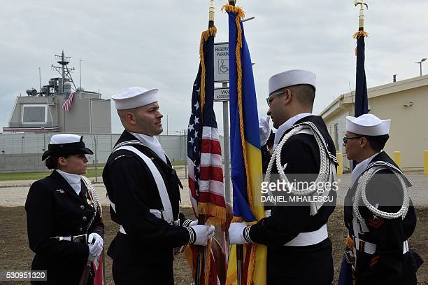 US Army personnel stand with the Romanian and the US flag during an inauguration ceremony of the US antimissile station Aegis Ashore Romania at the...