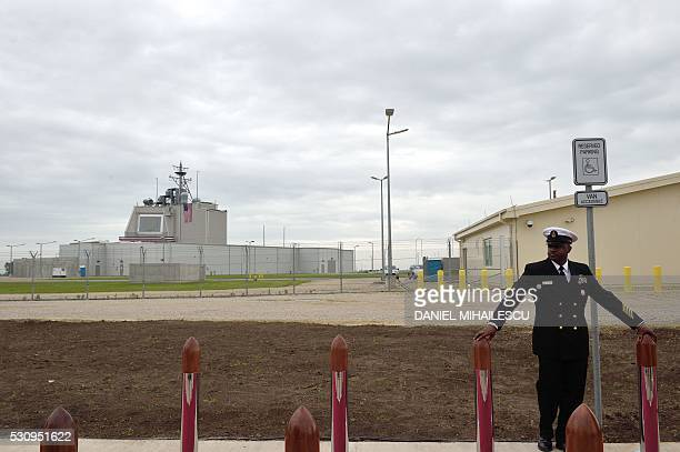 US Army personnel stands at the red carpet ahead an inauguration ceremony of the US antimissile station Aegis Ashore Romania at the military base in...