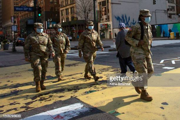 S Army personnel wearing masks cross 34th street on April 6 2020 in New York City The COVID19 death toll in the US is approaching 10000