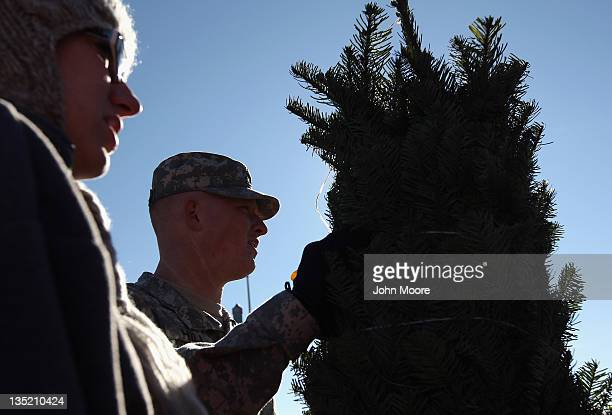 S Army Pfc Trey Hill and his wife Corina Hill stand with their free Christmas tree on December 7 2011 at Fort Carson in Colorado Springs Colorado...