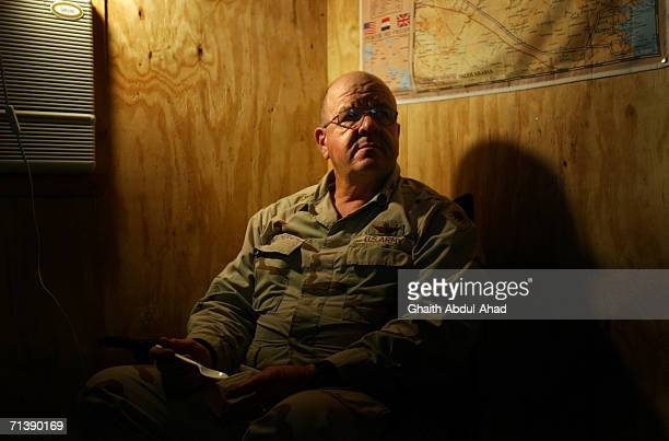 Army pilot CW3 Randy Weatherhead veterans of the Vietnam war eats dinner in his room on June 12 2005 in FOB Speicher Iraq